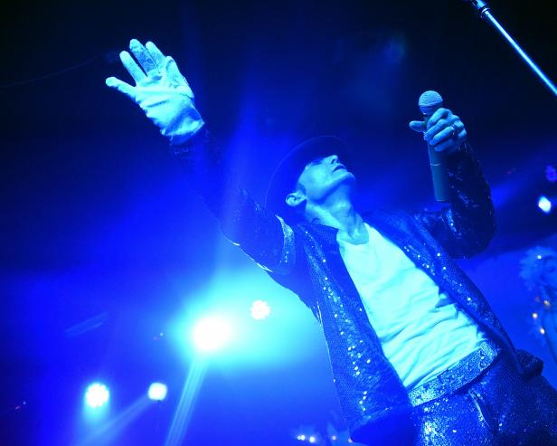 Corey Feldman performing at Michael Jackson tribute wearing a glove and hat given to him by Jackson [Chris McKay/Getty Images]