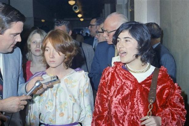 "Lynette ""Squeaky"" Fromme (left), and Catherine ""Gypsy"" Share, speaking outside the courtroom in the Los Angeles Hall of Justice after the hearing, January 27, 1970 [AP Photo/David F. Smith]"