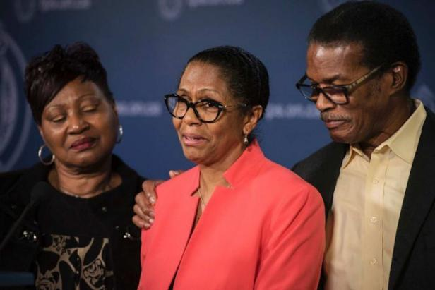 Lyneth Mann-Lewis with her family at a press conference in Toronto [Globe and Mail/ YouTube (screenshot)]