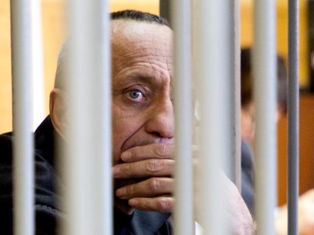 Mikhail Popkov looks through bars during a court session in Irkutsk, Russia, Monday, Dec. 10, 2018 [Julia Pykhalova, Komsomolskaya Pravda via AP]