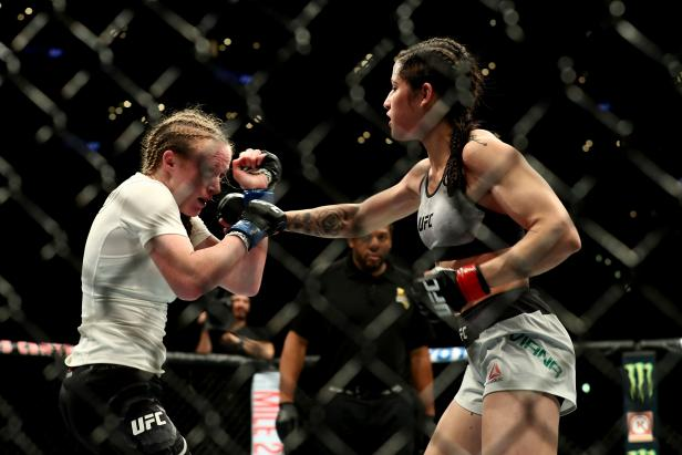 Polyana Viana throws a punch at JJ Aldrich in the second round of the women's straw weight bout during UFC 227 at Staples Center on August 4, 2018, in Los Angeles, United States [Joe Scarnici/Getty Images]