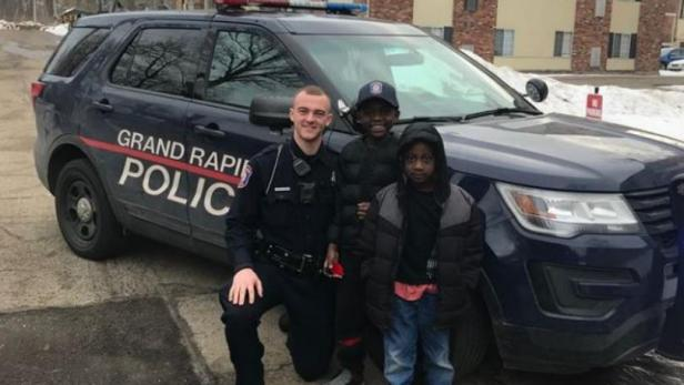 Officer Lynema, Thomas Daniel, and Thomas's brother [Grand Rapids Police Department]