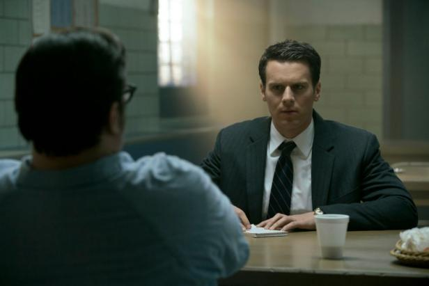 Jonathan Groff, as FBI Special Agent Holden Ford, based on John Douglas, confronts a killer across the table in Season One of the Netlix series 'Mindhunter'